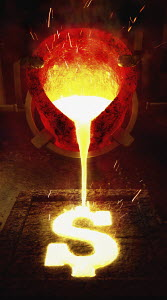 Molten metal pouring into dollar sign mold