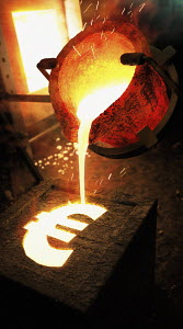 Molten metal pouring into euro sign mold