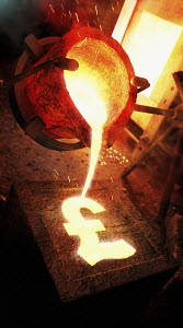 Molten metal pouring into pound sign mold