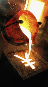 Molten metal pouring into yen sign mold