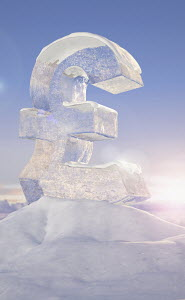 Frozen British pound sign on top of mountain peak in snowy landscape at sunrise