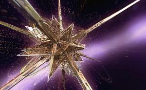 Complex abstract gold metallic angular three dimensional star shape