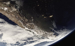 Digitally manipulated image of the Andes and city lights from space