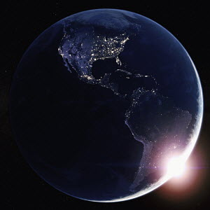 Sun rising over North and South America from space