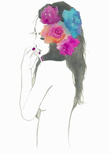 Contemplative woman with flowers in hair