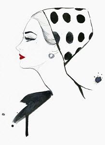 Elegant woman wearing polka dot pillbox hat