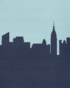 Silhouetted skyline of Empire State Building, New York