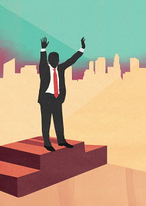 Businessman celebrating victory with arms raised on podium