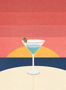 Cocktail on table with ocean sunset