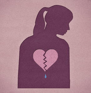 Silhouette of woman with a broken heart