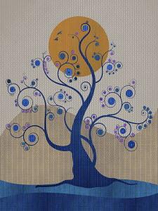 Sun behind delicate tendrils on blue tree