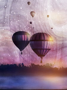 Ascending hot air balloons against pink sky