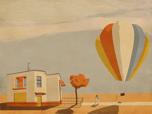 Couple hugging goodbye beside tethered hot air balloon