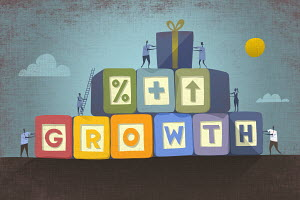 Businesspeople working together building single word 'growth' in building blocks