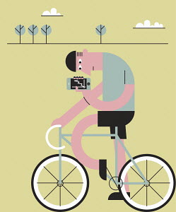Cyclist checking fitness app on mobile phone