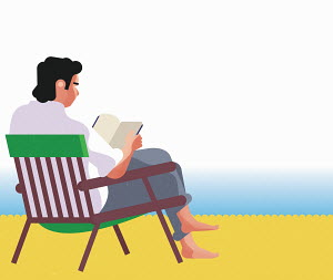 Man sitting, relaxing and reading on beach
