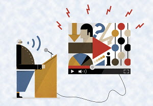 Man at podium talking through microphone connected to confusing arrows and data on computer monitor