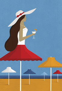 Beach parasol as woman wearing sun hat holding cocktail