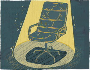 Spotlight over empty office chair for manager