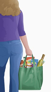 Woman carrying shopping bag of groceries