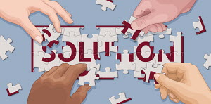 Hands cooperating to solve 'solution' jigsaw puzzle