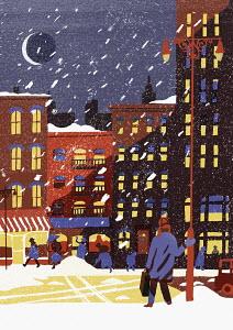 Snowy city street in winter at night