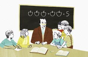 Teacher teaching mathematics to group of school children
