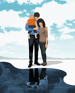 Family standing on the edge of deep water
