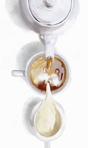 Overhead view of tea and milk pouring into teacup