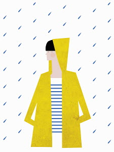 Girl wearing yellow raincoat with hood up in the rain