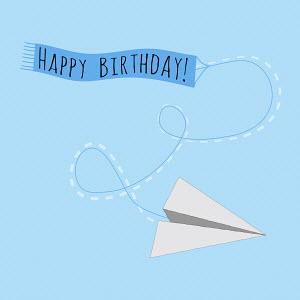 Paper plane pulling Happy Birthday banner