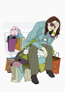 Exhausted woman surrounded by shopping bags