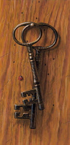 Old-fashioned keys hanging on nail