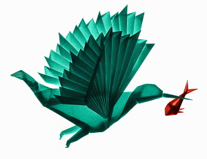 Origami bird flying with fish in beak