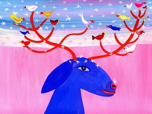 Birds perching on antlers of reindeer in snow