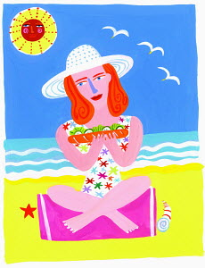 Woman on beach eating sandwich