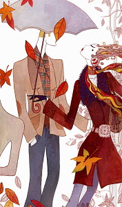 Stylish man and woman walking through falling autumn leaves in wind