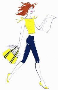 Beautiful woman carrying beach bag