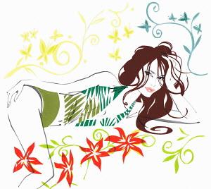 Beautiful woman laying in flowers