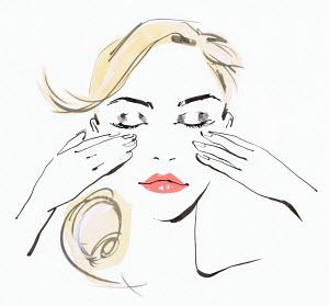 Beautiful woman massaging face