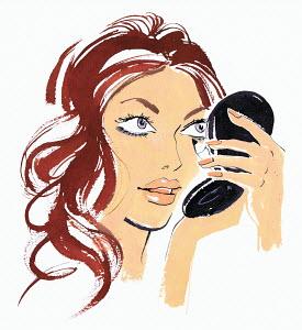 Beautiful woman applying eye liner
