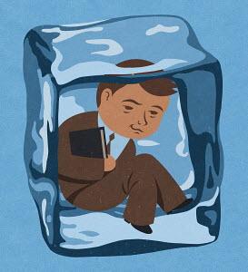 Businessman frozen inside of ice cube