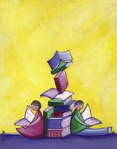 Children sitting reading leaning against pile of books