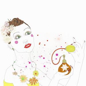 Woman spraying perfume from perfume atomizer