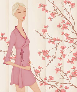 Beautiful elegant woman wearing pink mini dress standing with spring blossom