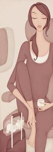 Beautiful woman on airplane massaging foot