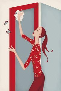 Beautiful woman dusting door frame