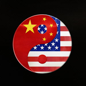 American and Chinese flags in yin and yang symbol