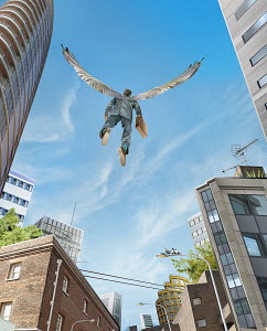 Successful businessman with wings flying over city