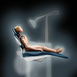 Crash test dummy in dentist's chair